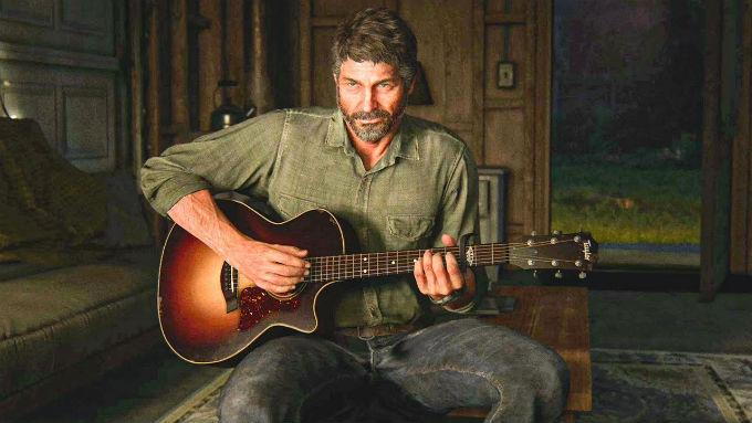 Joel tocando la guitarra en The Last of Us 2